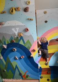 Kids Inside Rock Climbing Wall With Mural Sisters What