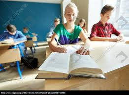group of students with books writing school test - Royalty free ...