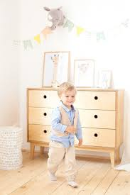 Premium Photo A Little Boy Puts Toys In A Scandinavian Basket For A Children S Room Eco Friendly Decor Child S Room Portrait Of A Boy Playing In Kindergarten Kids Room And Interior Design