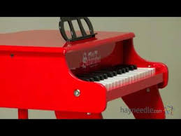 key red fancy baby grand piano