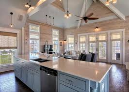 rustic great room with ceiling fan