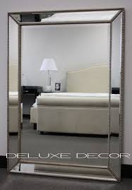 design large silver wall mirror