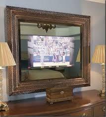 flat screen mounted behind 2 way glass