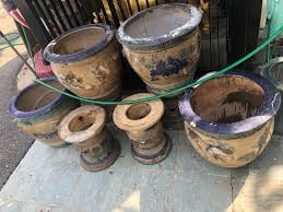 selling 4 nonya flower pots with stands