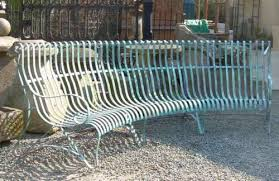 slatted curved metal bench in stroud