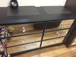 mirror and black chest of drawers or