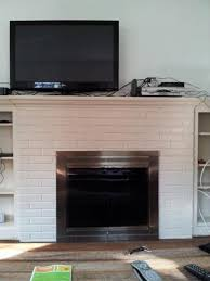 mounting tv above fireplace plaster