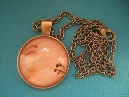 dog paw print in sand necklace pendant