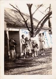 on the back- March 25, 1945 (Virgil Risley, Nola Smith Risley holding Betty  Risley Fillingham, Joy Risley Fountain holding Shirley Risle… | Risley,  Family tree, Mey