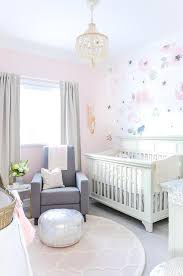 A Cream Beaded Chandelier Hangs Over A Round Pink Trellis Rug Ad Illuminates A Gorgeous Ivory And Pink Nursery Grey Baby Room Girl Nursery Room Baby Girl Room