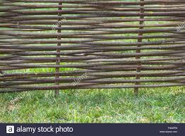 Fence Of Wooden Twigs On Green Grass Natural Tree Trunk Texture Garden Decor Barrier Border Boundary Spring Summer Season Stock Photo Alamy