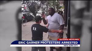 Protesters call for justice for Eric Garner on anniversary of his ...