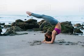 backwards practicing yoga pose