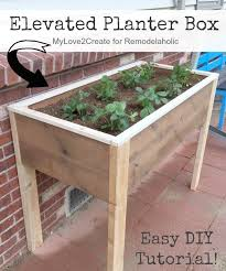 this diy elevated planter box is raised