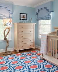 Different Color Wood Floors With Traditional Nursery Also Blue And Red Rug Blue Roman Shades Hexagon Rug Light Wood Crib Light Wood Dresser Light Wood Furniture Rope Floor Lamp Toddler Room White