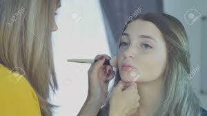 in a beauty salon make up artist