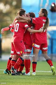 Adelaide players celebrate after teammate Adriana Jones scored a ...