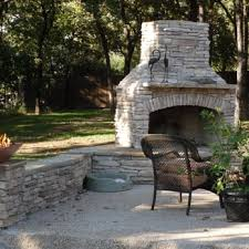 outdoor gas fireplace and sitting ledge