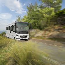 luxury rv can carry a smart car inside
