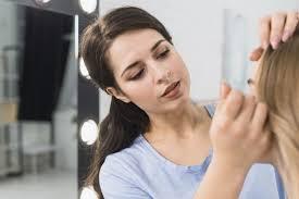 woman applying eyeliner brush making