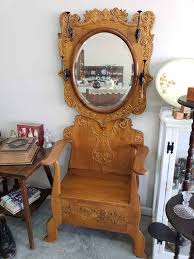 antique ornate oak hall tree with
