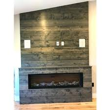 wood accent wall around fireplace panel