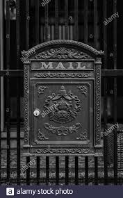 An Antique Mailbox On An Iron Fence Stock Photo Alamy