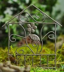 miniature rustic wire garden trellis or