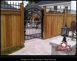 Wrought Iron Lattice And Gate On Cedar Fence Png Iron Garden Gates Wrought Iron Garden Gates Wrought Iron Fences