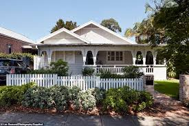 Quaint Front Facade With A White Picket Fence Hides A Spectacularly Modern Veranda Daily Mail Online