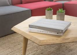 brown wooden coffee table with books