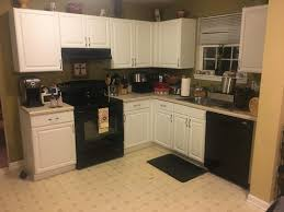 white cabinets and black appliances