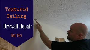 drywall nail pop in textured ceiling