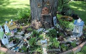 fairy garden at the base of a tree