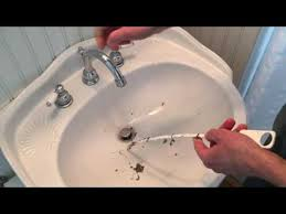 unclog a sink or shower drain
