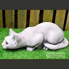 stone garden lying sleeping cat