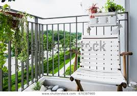 Outdoor Chair Sits On Balcony Inside Stock Photo Edit Now 670387900
