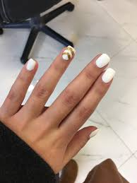 white nails with gold accent on we heart it