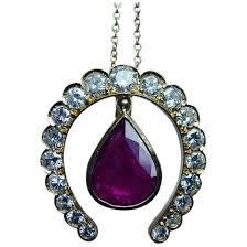 ruby 18k gold diamond horseshoe pendant