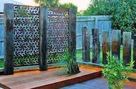 rusted steel and railway sleeper screen