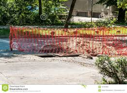 Street Construction And Reconstruction Site With Orange Safety Net Or Barrier Over The Open Manhole In The Asphalt Stock Image Image Of Home Field 121264805
