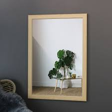 large natural wood framed wall mirror