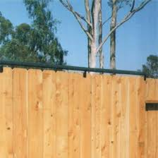 Coyote Rollers Keeps Dogs In Coyotes Out Fence Rollers Los Angeles Ca Coyote Rollers Dog Proof Fence Cat Fence