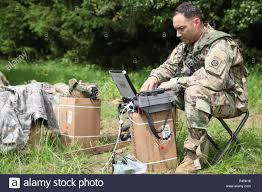 U.S. Army Lt. Col. Peter Gilbert, of 307th Brigade Support Battalion, 1st  Brigade Combat Team, 82nd Airborne Division updates mission details while  conducting an AirLand operations to establish lodgement during Swift  Response