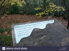 Carved wooden sign for Perry Wood in Kent England Stock Photo - Alamy