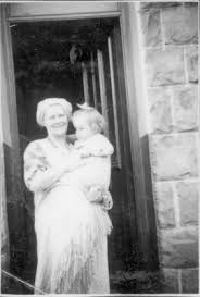 Ada Evans with baby Glynys outside their home in - iBase
