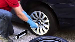 changing a flat tire on a bmw or mini