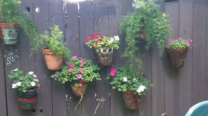 Awe Inspiring Hanging Plants On Fence Think About Coloring In A Special Stencil On Every One Of You Hanging Flower Pots Hanging Plants On Fence Hanging Plants