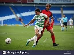 The New Saints's Aaron Edwards holds off FC Midtjylland's Jakob Poulsen  during the UEFA Europa League third qualifying round, first leg match at  Park Hall, Oswestry Stock Photo - Alamy