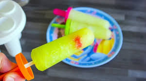 homemade midori sour flavored popsicles